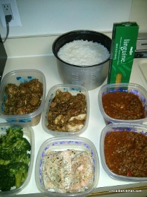 Uncle Ib's dishes: Chicken Yassa (left), Spaghetti sauce (right), cooked rice, broccoli, and baked salmon.